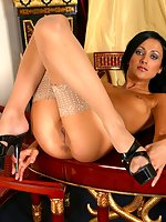 Gorgeous brunette Anna exposes in stockings